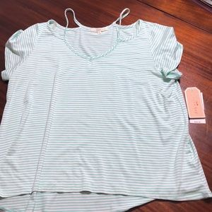 Strappy tee shirt.